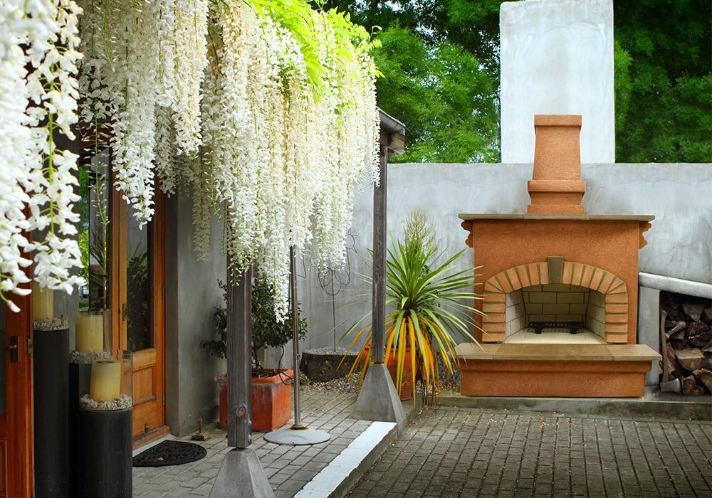 A carolina oven on a brick patio.