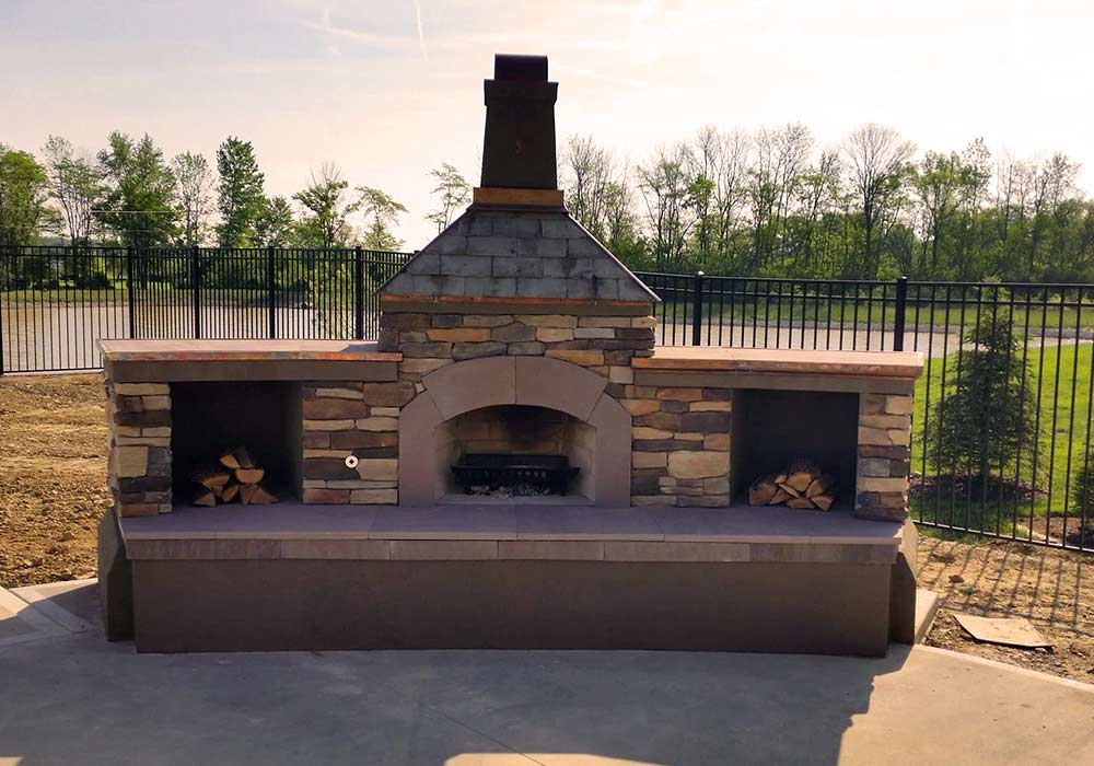 An upright fireplace with a chimney specifically built for this outdoor patio.