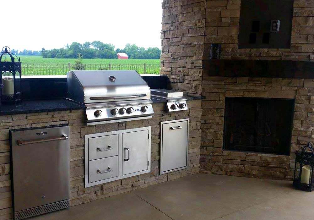A built-in outdoor kitchen and fireplace for the ultimate entertainment space.