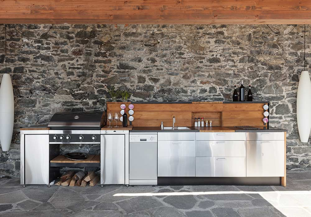 A gorgeous, stainless steel kitchen with wood accents for your outdoor entertainment area.
