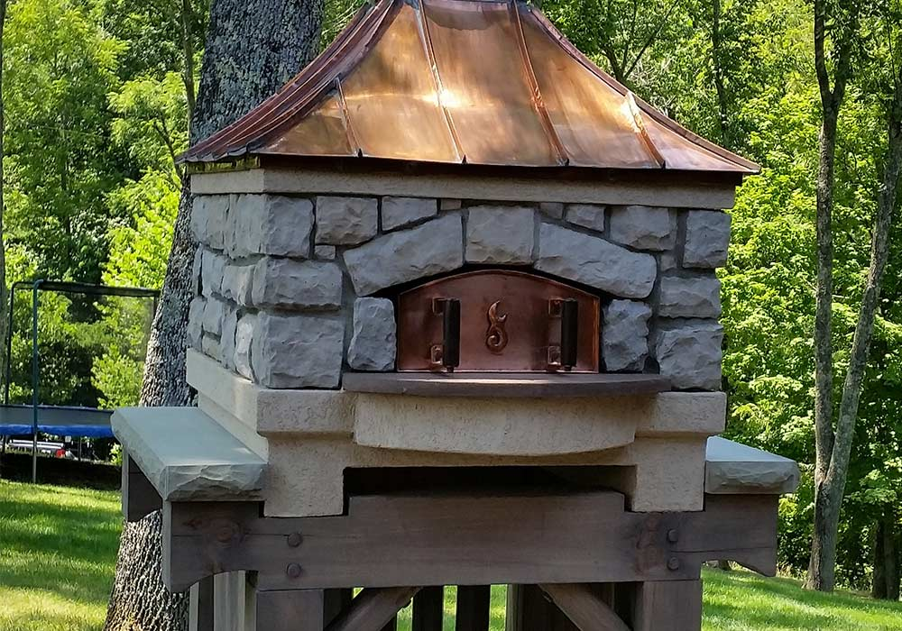 A premium wood fire oven built for your outdoor living space.