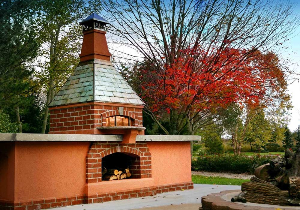 A red brick, wood fire oven on a crispy Fall day.